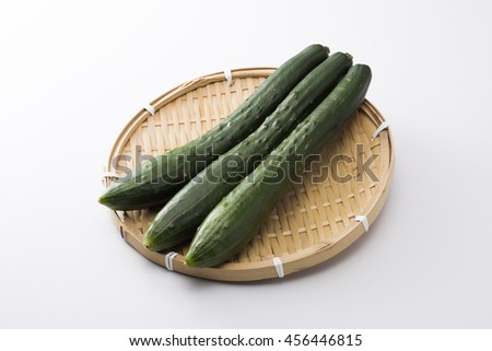 Cucumber on the colander - stock photo