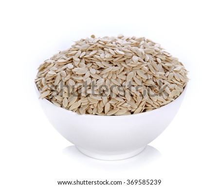 cucumber seeds in bowl on white background
