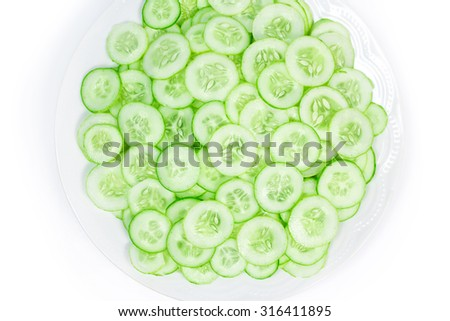 cucumber slice in plate isolated on white background - stock photo