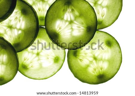 Cucumber slices as background - stock photo