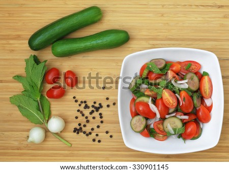 Cucumber-Tomato Salad - stock photo