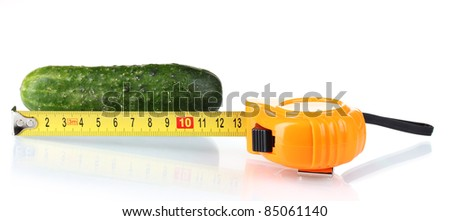 Cucumber with measuring tape isolated on white