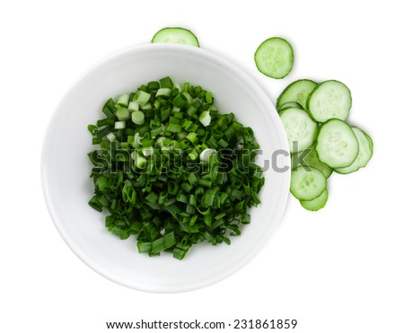 Cucumbers and green onions sliced for salad. White background. Clipping path. - stock photo