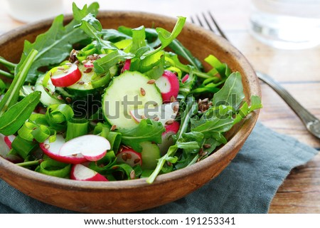 cucumbers and radishes in a salad, food closeup
