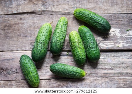 Cucumbers on a wooden background - stock photo