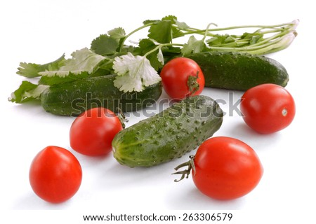 cucumbers, tomatoes and greens isolated on white background - stock photo