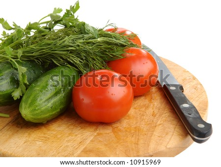 Cucumbers, tomatoes, fennel and knife - stock photo