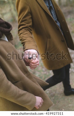 Cuddling couple. Couple in love. Love couple. Love hug. Hand with hand