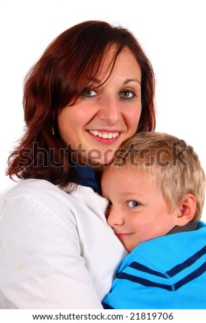 Cuddling With Mommy A single mother with her young son. Isolated over white.
