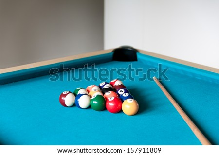 cue and balls are on the table for billiard - stock photo