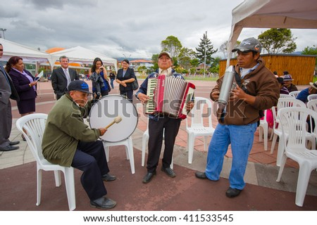 Cuenca, Ecuador - April 22, 2015: Local band of older people performing on city square using accordion, drums and metal shakers - stock photo