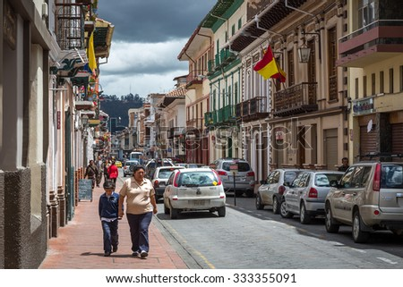 Cuenca, Ecuador - 10th August 2015 - Local people walking around in a blue sky day in the old town in Cuenca, Ecuador, South America