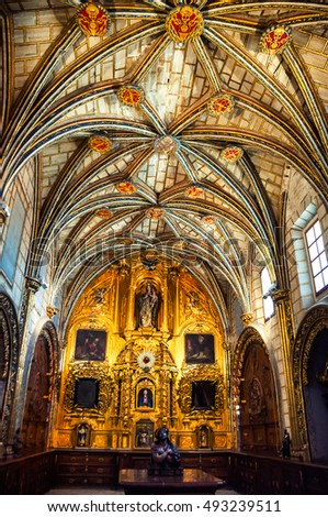 CUENCA, SPAIN - JULY 18, 2012: Inside famous Gothic Catholic Cathedral. Golden altar and overall beautiful decoration of the walls and ceiling.