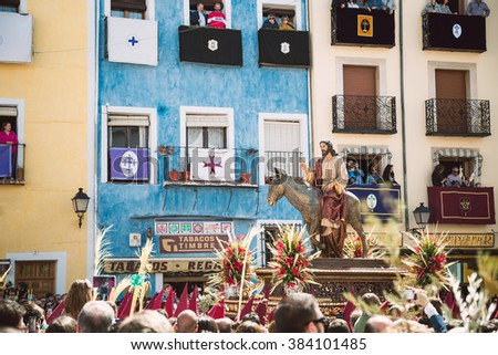 CUENCA, SPAIN - MARCH 29, 2015 - People in The Hosanna Procession during Holy Week in Cuenca, Spain, March 29, 2015. - stock photo