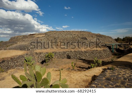 Cuicuilco pyramid in Mexico City. Circular pyramid with nopal at the foreground.