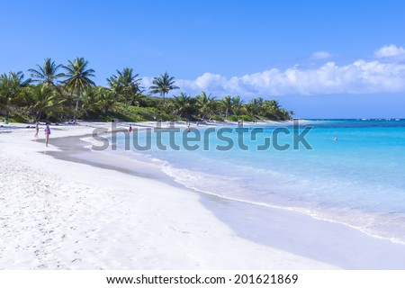 CULEBRA, PUERTO RICO - JANUARY 21, 2014: Vacationers enjoy the clear blue water and warm sunshine on one of the world's best beaches, Flamenco Beach, on the Puerto Rican island of Culebra - stock photo