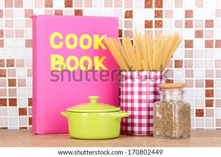 Culinary composition in kitchen on table on mosaic tiles background - stock photo