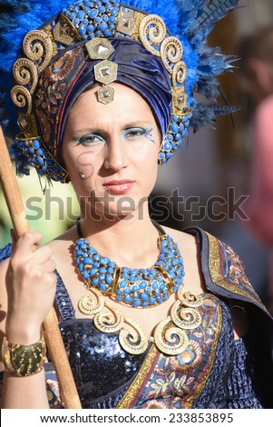 CULLAR, SPAIN - APRIL 26: Unidentified participant at Fiesta Moros and Cristianos, participate in a costume parade on the streets of Cullar, Granada April 26, 2014 - stock photo