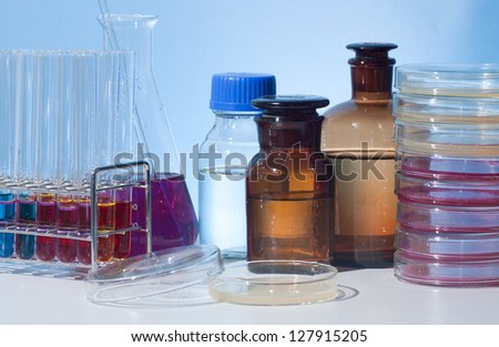 culture dish and other glass laboratory apparatus in desk - stock photo