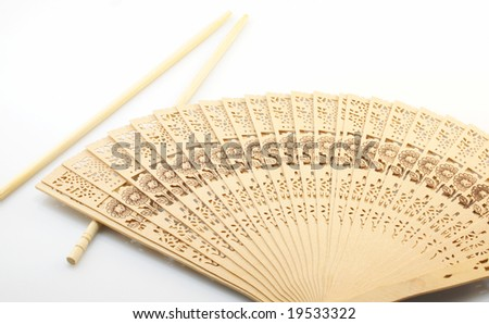 Culture of China, sticks and fan on a white background - stock photo