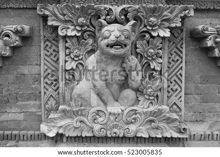 culture stone carving on temple pura Dea Batuan wall, Bali,Indonesia