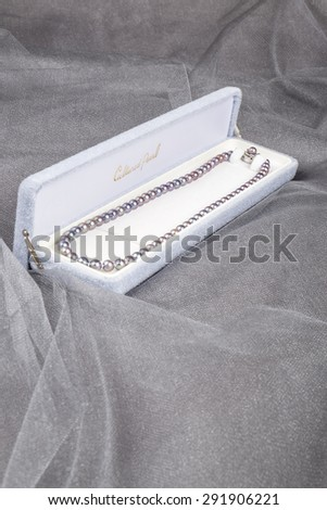 Cultured Black Pearls Necklace in a Jewelry Box - stock photo