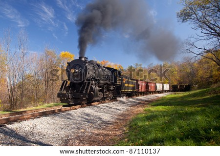 CUMBERLAND, MD - OCTOBER 17: Western Maryland Railroad steam train on October 17, 2011 in Cumberland, Maryland. This scenic railroad offers excursions on a 1916 Baldwin locomotive. - stock photo
