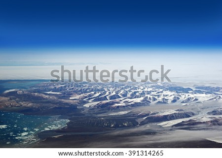 Cumberland Peninsula Mountains, Nunavut, Canada - aerial view from 12000 meters - stock photo
