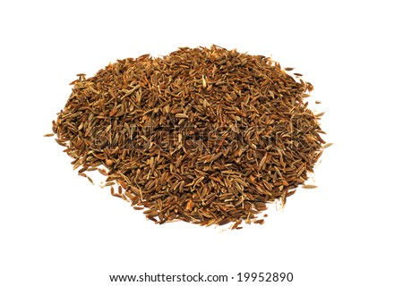 Cumin seeds on a white background