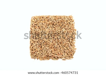 Cumin seeds on white background