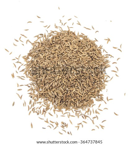 Cumin seeds or caraway isolated on white - stock photo
