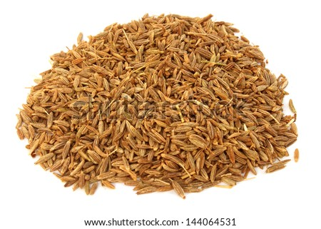 cumin seeds over white background