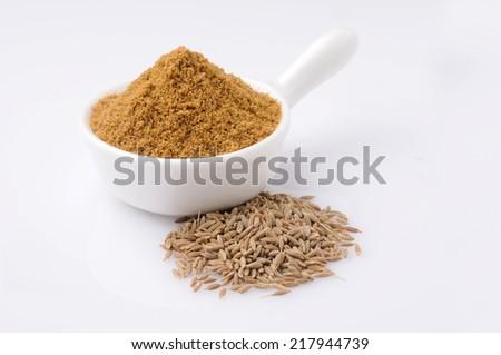 cumin seeds with powder (Ground cumin ) - stock photo