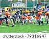 CUMMING, GA - OCT 17: Scrimmage line of a football game. A team of 7-9 year old boys October 17, 2009 in Cumming GA.  The Broncos vs The Eagles. - stock photo