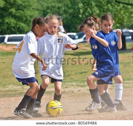 CUMMING, GA/USA - MAY 8: Unidentified young girls during a soccer game May 8, 2010 in Forsyth, County, Cumming, GA.  A regular season game of girl's 8 and under. The Fusion Fury vs the Cheetahs. - stock photo