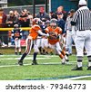 CUMMING, GA/USA - OCTOBER 17: Unidentified boys handing off the football. A team of 7-9 year old boys October 17, 2009 in Cumming GA.  The Broncos vs The Eagles. - stock photo