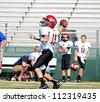CUMMING, GA/USA - SEPTEMBER 8: Unidentified boy ready to throw a pass during a football game. A team of 7th grade boys September 8, 2012 in Cumming GA. The Wildcats  vs The Mustangs. - stock photo