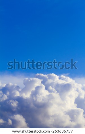 Cumulus and sky background. A big rain cloud is going to became a storm cloud. - stock photo