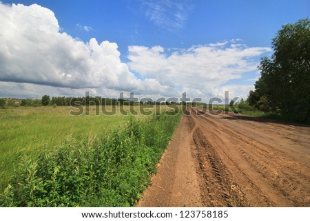 Cumulus clouds above the road in the steppe. Omsk Region. Russia.