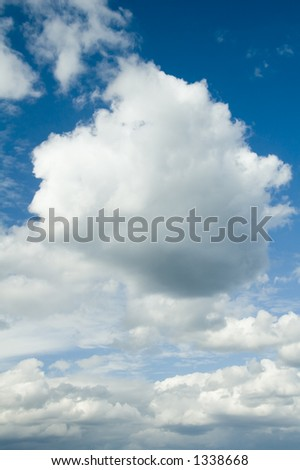 Cumulus clouds and blue sky before a storm - stock photo