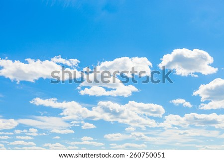 Cumulus clouds, blue sky and sun - outdoors shoot - stock photo