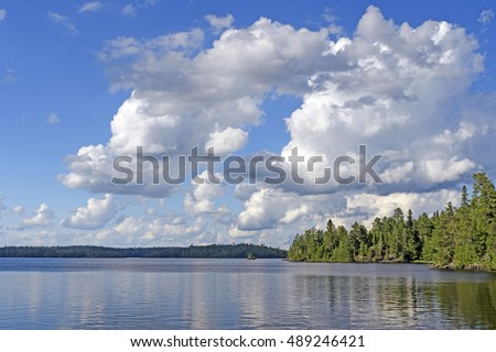 Cumulus Clouds over the North Woods on Saganagons Lake in Quetico Provincial Park in Canada