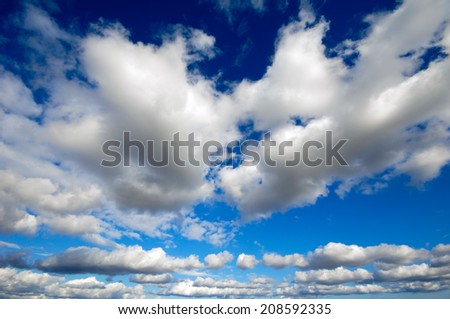 Cumulus cloudscape and a blue sky - stock photo