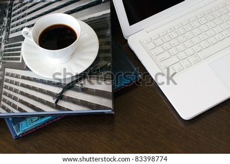 cup and glasses on a book