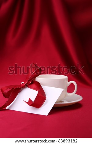 Cup and note card - stock photo