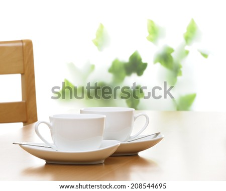 cup and saucer on the table - stock photo