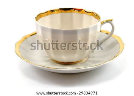 cup and saucer with gold trim isolated on white