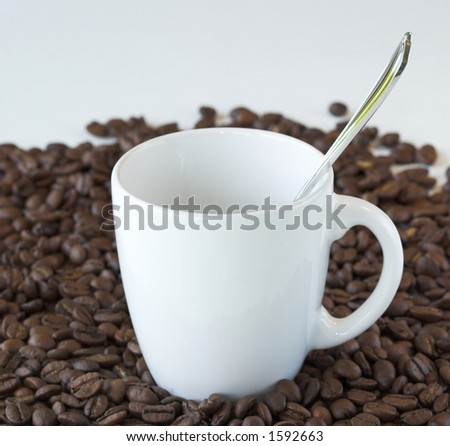 Cup and spoon and coffee beans