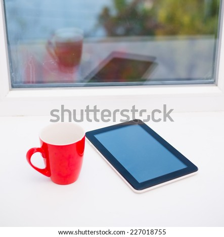 cup and tablet - stock photo