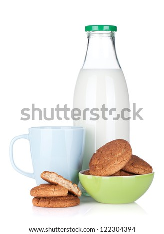 Cup, bottle of milk and cookies. Isolated on white background